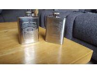 Two Jack Daniels stainless steel hip flasks
