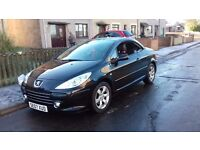 PEUGEOT 307 ALLURE HARD TOP CONVERTIBLE. BLACK AND RED LEATHER INTERIOR