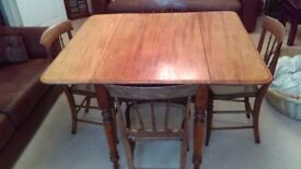 VICTORIAN PEMBROKE STYLE DINING TABLE, BRASS CASTORS AND SIX DINING CHAIRS