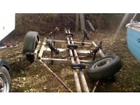 Breakback dayboat trailer. Restoration project, needs x2 new axles. Frame in reasonable condition.