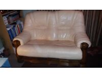 2 X Cream leather 2 seater Sofas. Dark Wooden Frames with 2 pull out drawers underneath.