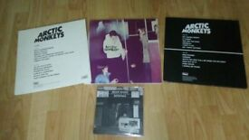 "3 x artic monkeys vinyl LP's + bonus 7"" when the sun"