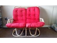 Cushioned two seater wicker sofa