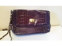 Purple bag with long chain so can be worn on shoulder or as clutch