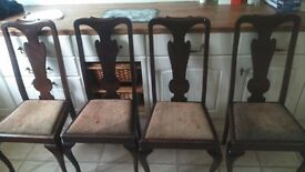 Four Eagle claw feet dark wood chairs