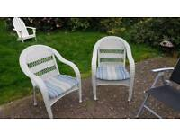 2 outdoor patio wicker style arm chairs