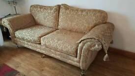 3 seater sofa. Gold damask pattern.