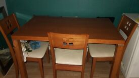 pine table and 3 chairs