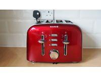 Red 4 slice Breville toaster