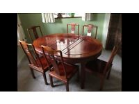 Solid rosewood dining table and six chairs