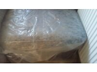 Brand knew setee and buffet still in plastic silver cushion black leathet