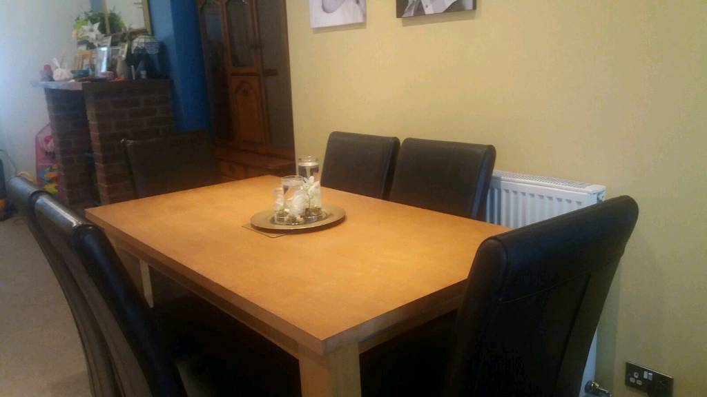 Solid Oak Dining Table With Six Brown Leather Chairs