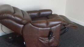 Electric Relcining brown leather arm chair brilliant condition with remote