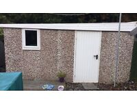 Concrete interlocking shed can be transformed into garage by adding up and over door