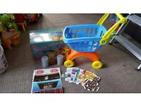 Childs shopping trolley and play food