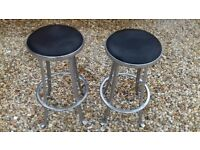 Bar stools in quality cast aluminium with padded black seat
