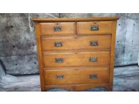 Solid wood pine chest of drawers. 2 handles are broken