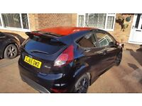 Fiesta Ecoboost. Black with red roof, wingmirrors and trim.