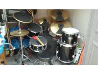 Drum Kit with 3 crash cymbals and one ride and mute pads included.