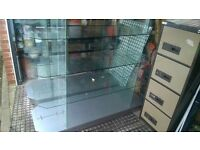 Glass shelving display cabinet , from collectables retail store .