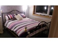 Classic style metal bedstead purple and brass headboard and footboard, with white finial