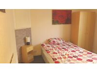 Large single room available in a 2 bedroom flat close to Square