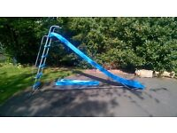 Blue 3 meter long TP Activity slide with extension. 1.5 meter high