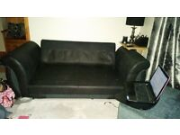 Brand new 2 seater sofa base free to first person to collect black/grey