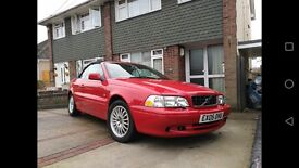 Volvo c70 convertible, red, creme leather, low milage