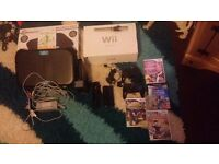 Black Wii console and Wii fit board !
