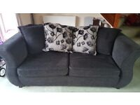 Sofa bed, round chair and foot stool