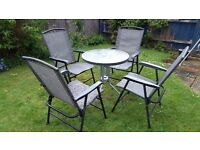 Garden table and chair set: glass table and four chairs - good condition