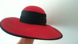 RED HAT WITH BLACK RIBBON AND BLACK EDGE TRIM - GOOD CONDITION.