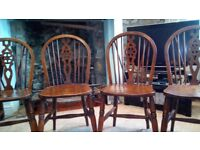 Four lovely solid wooden kitchen/dining chairs