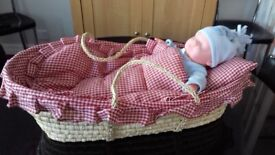 CARRY COT WITH NEW BORN DOLL.