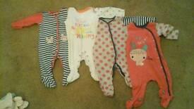 Ten 3-6 month sleepsuits