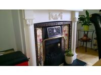 Cast Iron fireplace with tiled inset