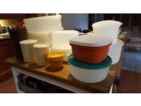 Various large Tupperware containers, round and square, and 4 cannisters, all with lids.