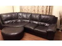 Large dark brown leather corner sofa and poufe for sale £100