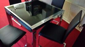 Black and Chrome expanding glass Top Dining Table with Chairs