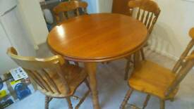 Round extendable solid table with 4 chairs