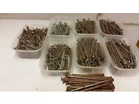 boxes of nails sizes 5in, 4in, 3in and 2 in