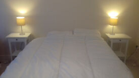 King Size Bed and bedside tables for sale. New last November.