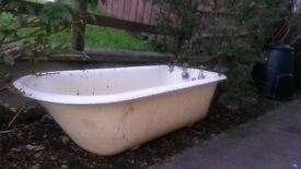 Beautiful vintage roll top cast iron bath with globe taps