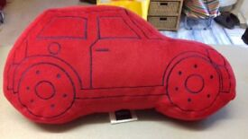 Red 'Car-shaped' Cushion. Machine washable. 43cms x 22cms. Excellent condition.