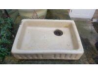 Cream ceramic butler style shallow sink