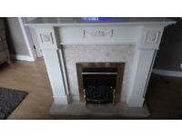 Marble Fireplace with white wooden surround and coal effect electric fire