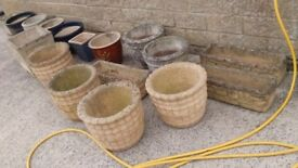 A collection of very heavy stone plant pots