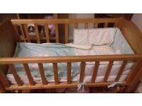 Beautiful solid wooden swinging crib for sale