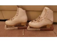 Ladies White ice skating boot with blade protectors